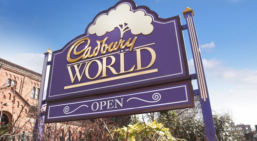 Cadbury World sign photo with Cadbury factory in the background