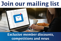"Woman using a laptop accessing her email inbox while eating a croissant framed by the copy ""Join our mailing list Exclusive member discounts, competitions and news"""