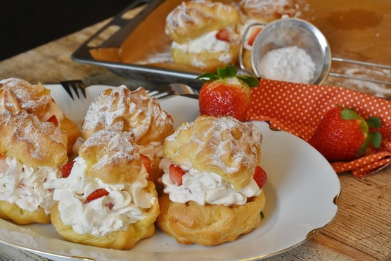 Scones filled with cream and strawberries - A Cream Tea.