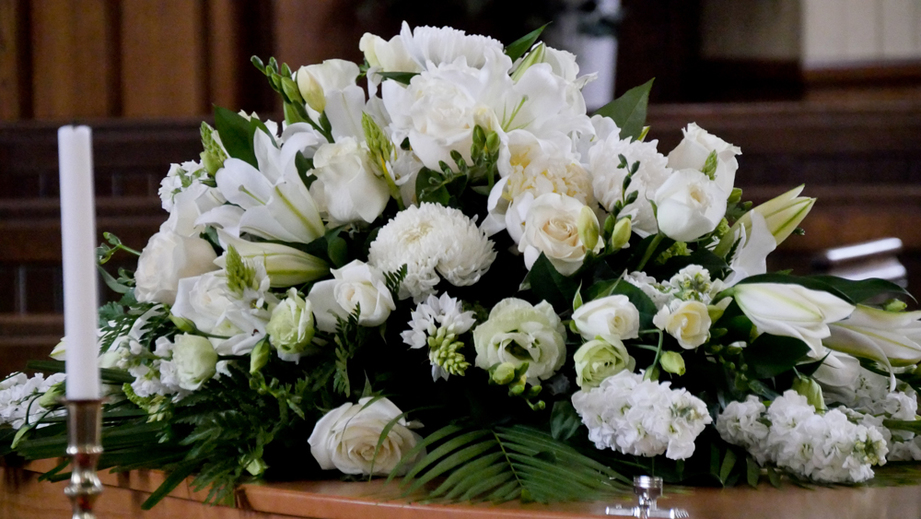 White flower arrangements for a funeral