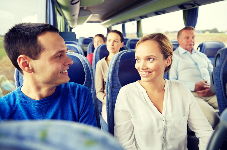 An image of happy people on a coach trip